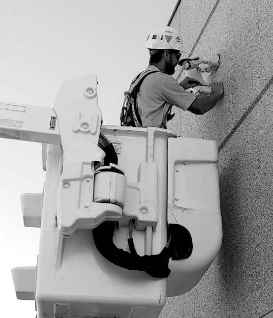 Live Patrol installing remote camera security with a bucket truck
